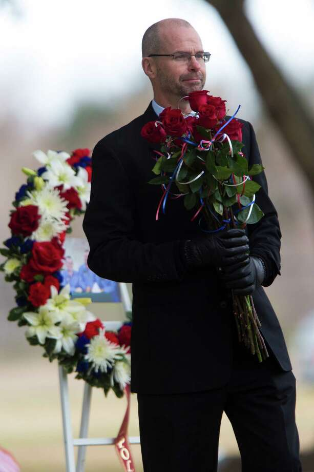 Robert Hanley waits for his turn to pay respect to fallen crew members of the Apollo 1 and space shuttles Challenger and Columbia during NASA's Day of Remembrance, Thursday, Jan. 30, 2014 at NASA's Johnson Space Center in Houston. Photo: Marie D. De Jesus, Houston Chronicle / © 2014 Houston Chronicle