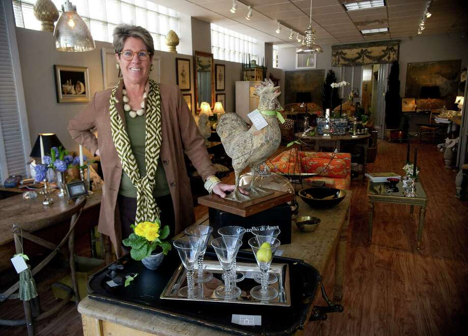 Lynn Hamlen poses for a photo in her Darien store, Folly Design Elements, on Thursday, January 30, 2014. Photo: Lindsay Perry / Stamford Advocate