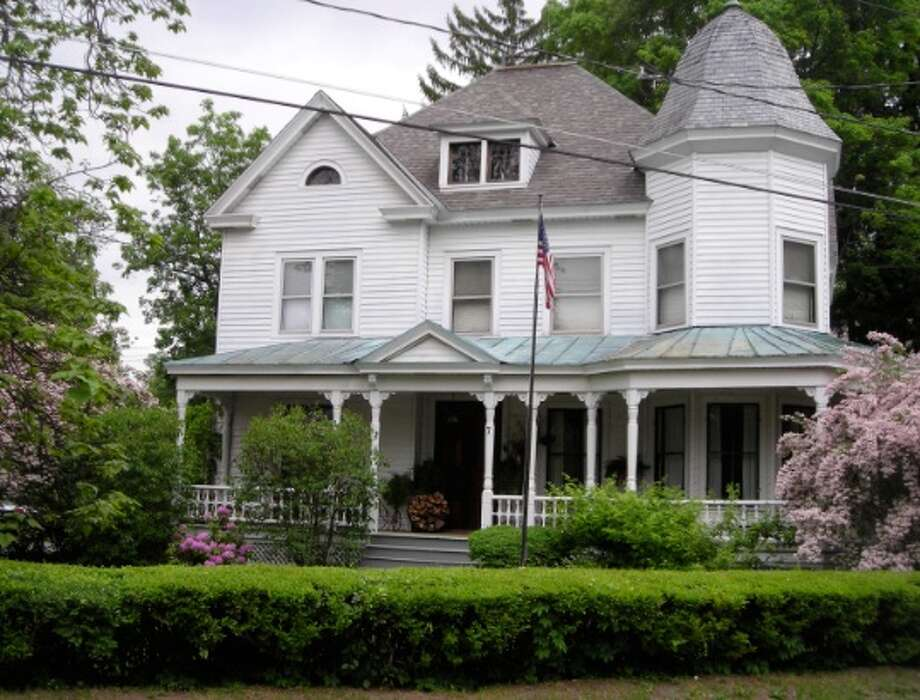 Bob and Linda Connors are selling their large, 1870s-era Jacobean Victorian in the heart of Round Lake, near Global Foundries in Saratoga County. This 3,100-square-foot home features 4 bedrooms, 2.5 bathrooms, library, wood-burning fireplace, wraparound porch, detached garage and more, in the Shenendehowa school district. Contact Bob and Linda at 518-899-2819 for more information on their home, priced at $325,000. Photo: Robert Connors, Photo Courtesy The Connors
