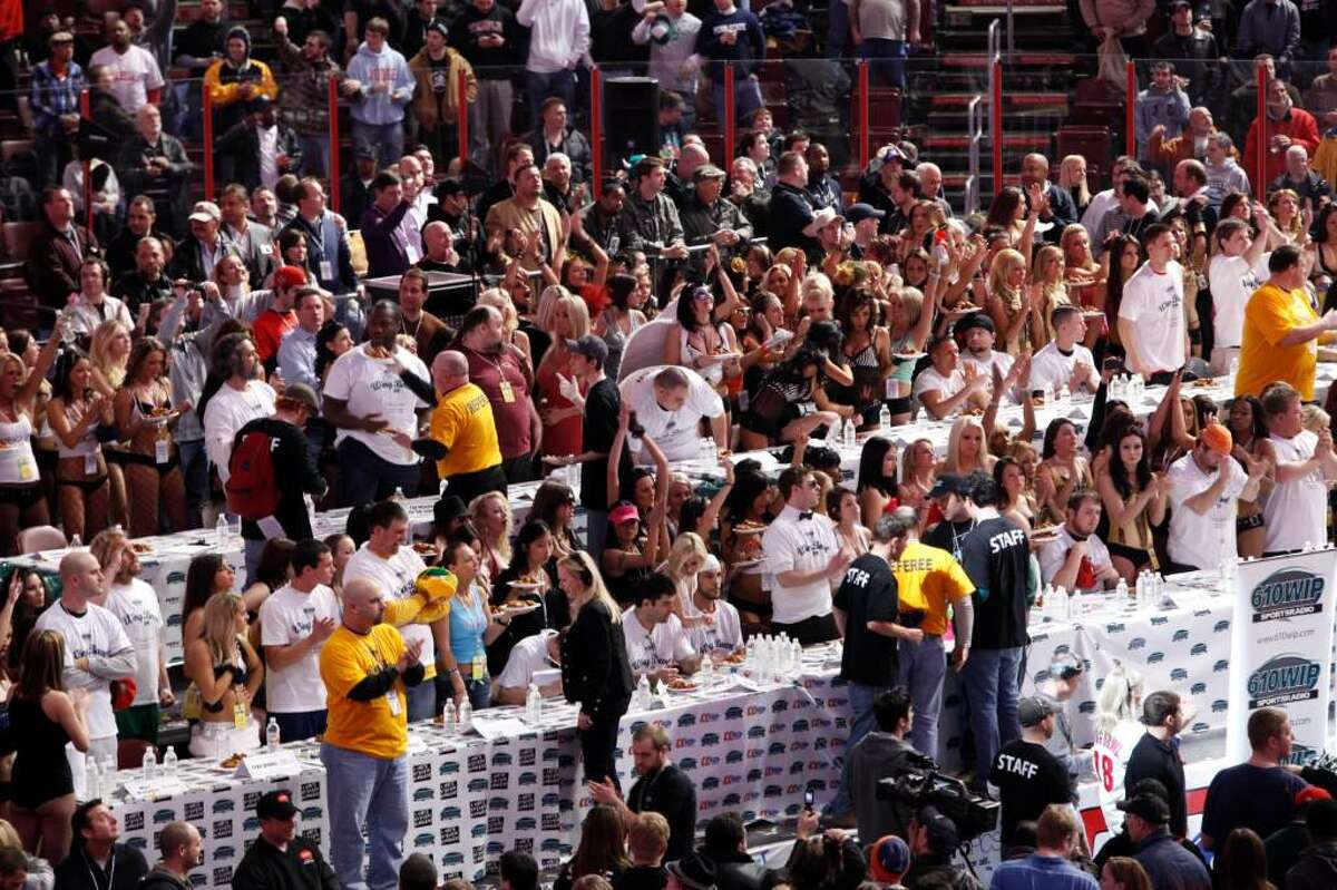 """""""Eaters"""" and """"Wingettes"""" prepare for Wing Bowl 18, the 18th annual wing eating contest held before the Super Bowl, in Philadelphia, Friday, Feb. 5, 2010. (AP Photo/Matt Rourke)"""