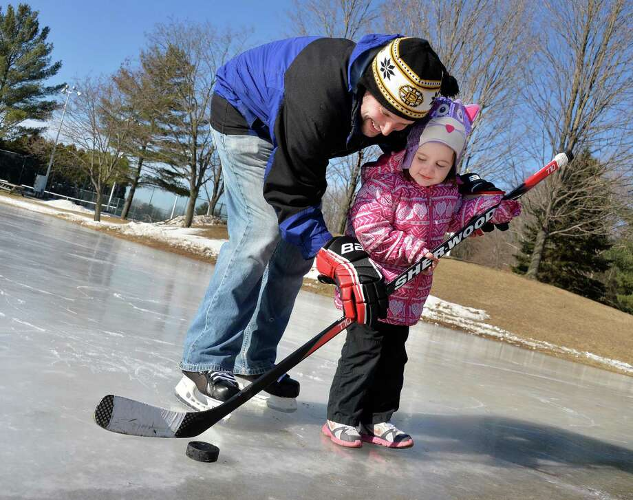 Tim Guernsey of Bethlehem gives his 4-year-old niece Isabella Guernsey of Albany a hockey lesson at Elm Avenue Park Thursday, Jan. 30, 2014, in Bethlehem, N.Y.  (John Carl D'Annibale / Times Union) Photo: John Carl D'Annibale