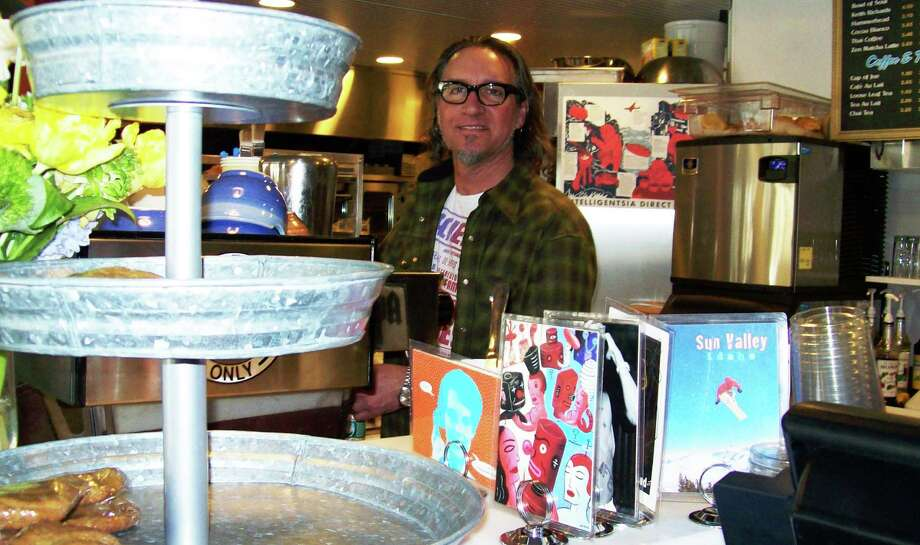 Todd Rippo, an owner of Java, stands behind the counter at the newly-opened coffee house on Church Lane. Photo: Anne M. Amato / Westport News