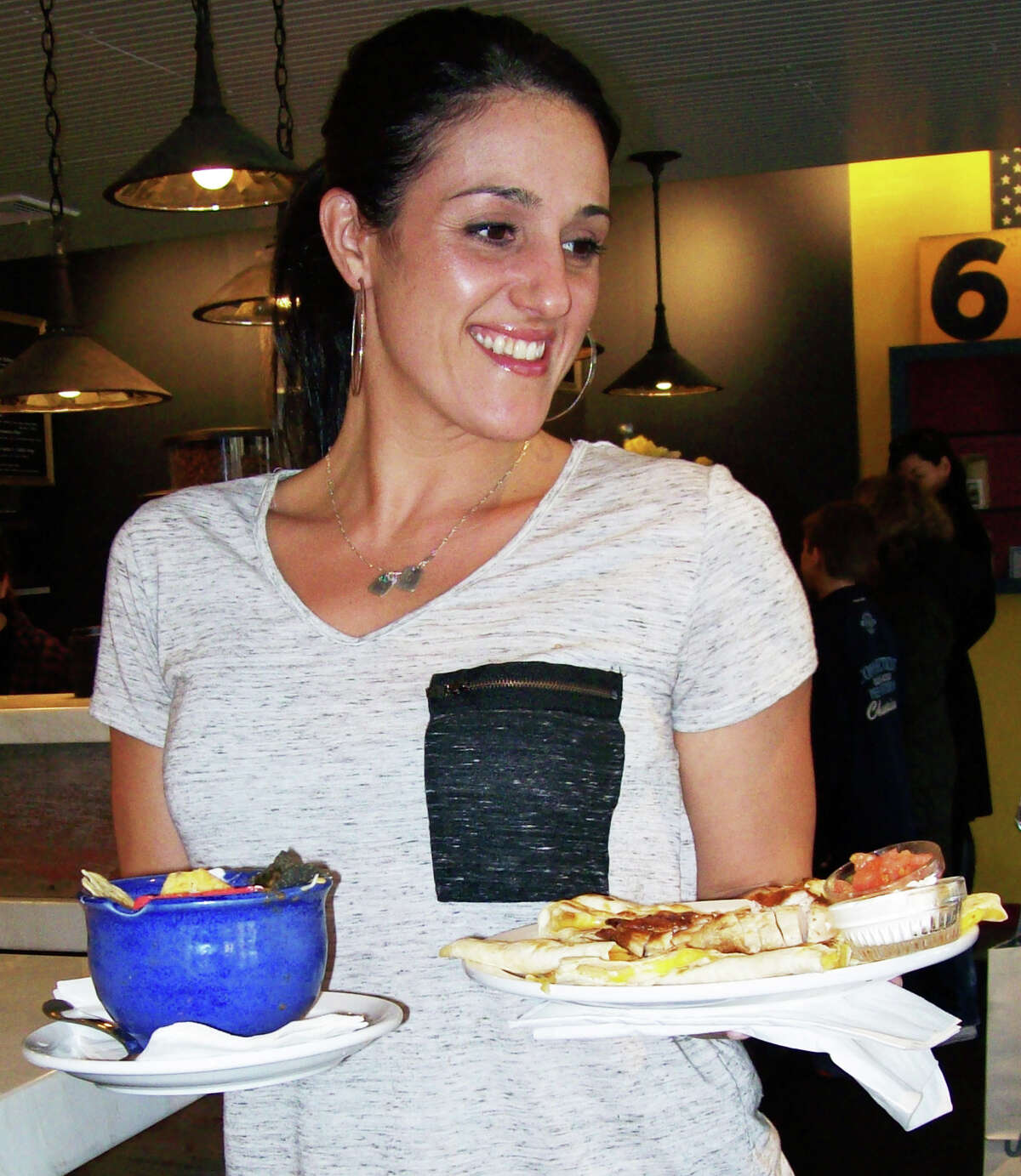 Erica Singer serves up lunch at Java, the new coffee house on Church Lane.