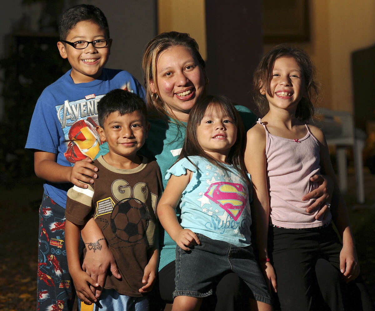 Irma Aguilar's children are covered by Medicaid, but she is not.