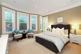 This bedroom includes built-in speakers and large windows.