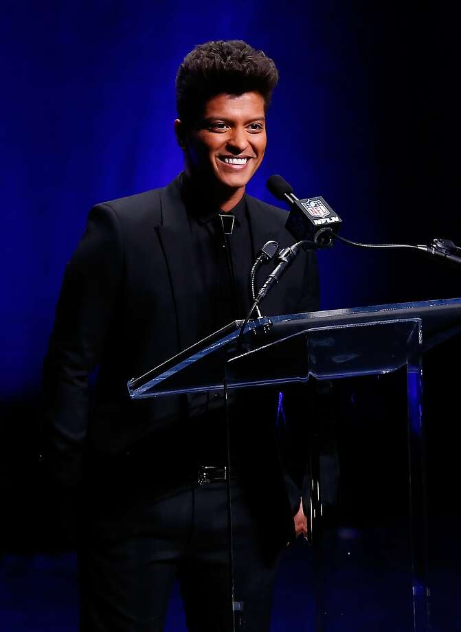 NEW YORK, NY - JANUARY 30:  Singer Bruno Mars speaks during the Pepsi Super Bowl XLVIII Halftime Show Press Conference at the Rose Theater, Jazz at Lincoln Center on January 30, 2014 in New York City.  (Photo by Alex Trautwig/Getty Images) Photo: Alex Trautwig, Getty Images