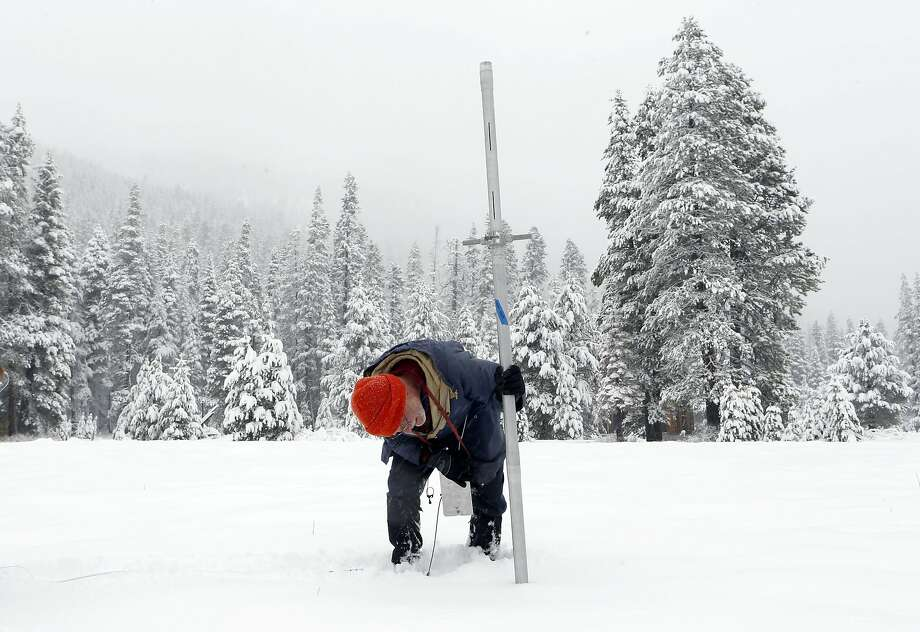 "Frank Gehrke, head of the California Cooperative Snow Survey Program, takes snow-level readings at Phillips Station in the Sierra. Snowfall is at a record low during what the governor calls a ""mega-drought."" Photo: Michael Macor, The Chronicle"