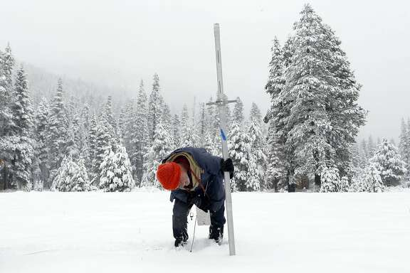 Frank Gehrke, the Chief of the California Cooperative Snow Survey Program takes snow level readings at Phillips Station, Calif. on Thursday Jan. 30, 2013. After the survey Gehrke reported that at present the snow pack is at just seven percent of a normal snow season.
