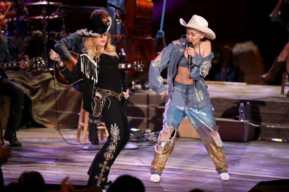 Recording artists Madonna (L) and Miley Cyrus perform onstage during Miley Cyrus: MTV Unplugged at Sunset Gower Studios on January 28, 2014 in Hollywood, California. Photo: Christopher Polk, Getty Images For MTV