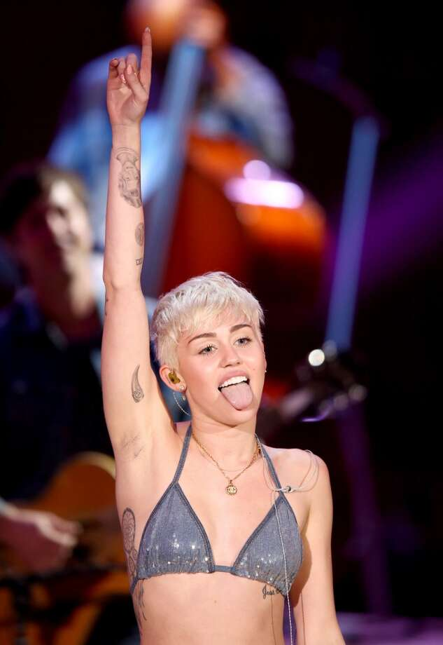 Recording artist Miley Cyrus performs onstage during Miley Cyrus: MTV Unplugged at Sunset Gower Studios on January 28, 2014 in Hollywood, California. Photo: Christopher Polk, Getty Images For MTV