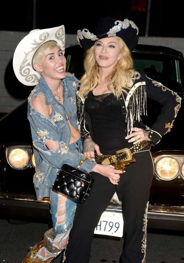 Recording artists Miley Cyrus (L) and Madonna during Miley Cyrus: MTV Unplugged at Sunset Gower Studios on January 28, 2014 in Hollywood, California. Photo: Jeff Kravitz