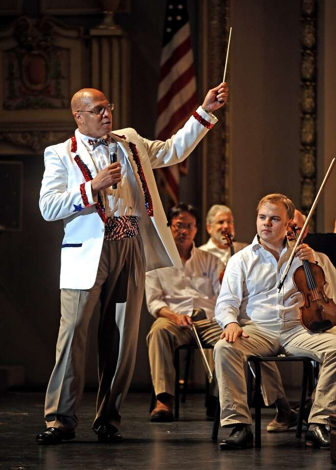 Music Director, Chelsea Tipton II, and the Symphony of Southeast Texas  open up their 4th of July Celebration show on Thursday, July 4, 2013 at the Julie Rogers Theater.  Photo taken: Randy Edwards/The Enterprise
