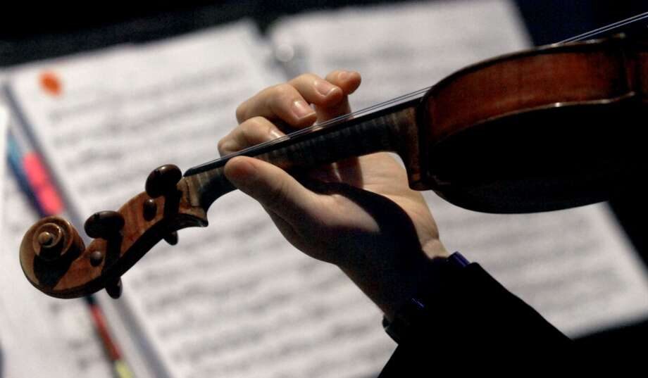 "A stringed quartet performs during the reception at the Symphony of Southeast Texas fundraiser,  ""A Night to Remember""  Symphony Ball presented by the Symphony League of Beaumont at the Beaumont Civic Center in Beaumont, Saturday, February 4st, 2012. Tammy McKinley/The Enterprise"