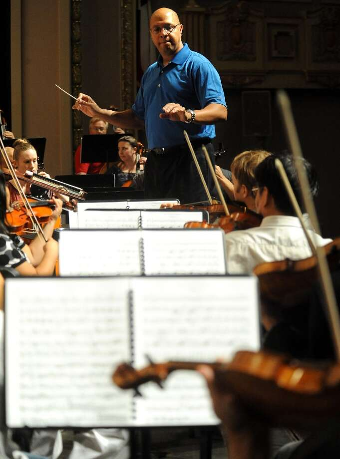 Conductor Chelsea Tipton leads the Symphony of Southeast Texas during rehearsal at the Julie Rogers Theater in Beaumont, Tuesday,  September 20, 2011. Tammy McKinley/The Enterprise