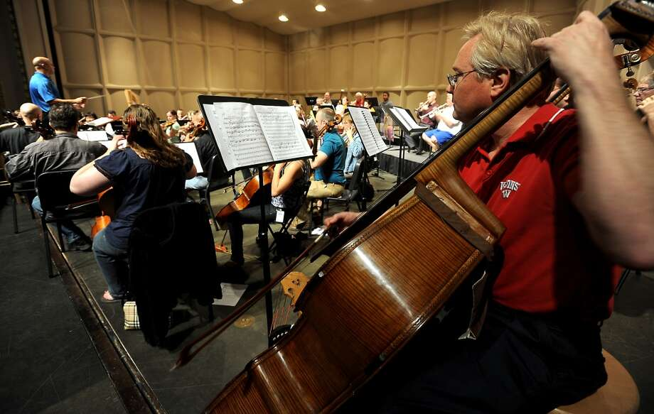 The Symphony of Southeast Texas rehearses for the opening season at the Julie Rogers Theater in Beaumont, Tuesday,  September 20, 2011. Tammy McKinley/The Enterprise