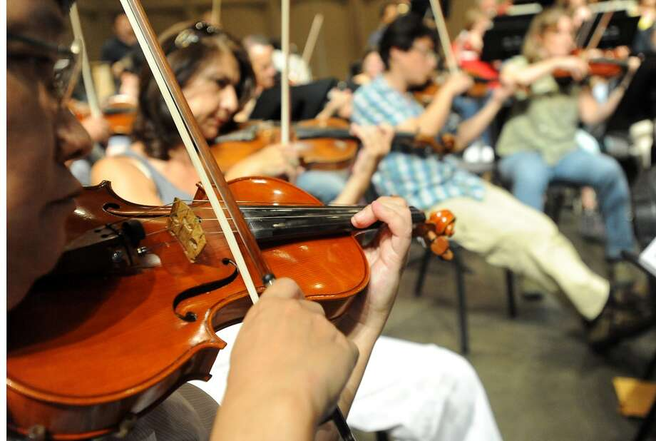 Musicans with the Symphony of Southeast Texas rehearse at the Julie Rogers Theater in Beaumont, Tuesday,  September 20, 2011. Tammy McKinley/The Enterprise