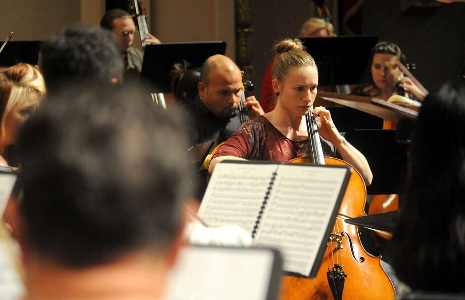 The Symphony of Southeast Texas rehearses for the season opener at the Julie Rogers Theater in Beaumont, Tuesday,  September 20, 2011. Tammy McKinley/The Enterprise
