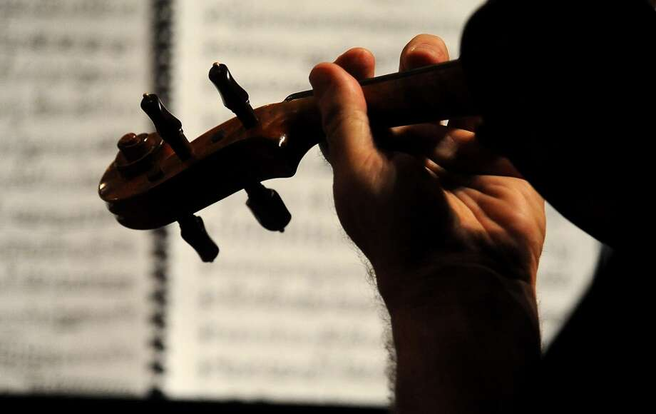 Musicians with the Symphony of Southeast Texas rehearse at the Julie Rogers Theater in Beaumont, Tuesday,  September 20, 2011. Tammy McKinley/The Enterprise