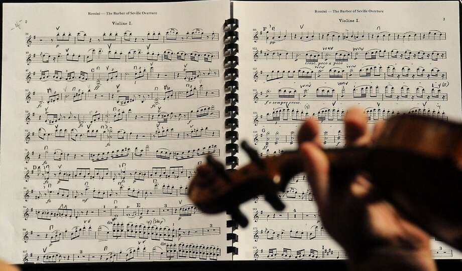 The Symphony of Southeast Texas rehearses for their season opening concert at the Julie Rogers Theater in Beaumont, Tuesday,  September 20, 2011. Tammy McKinley/The Enterprise