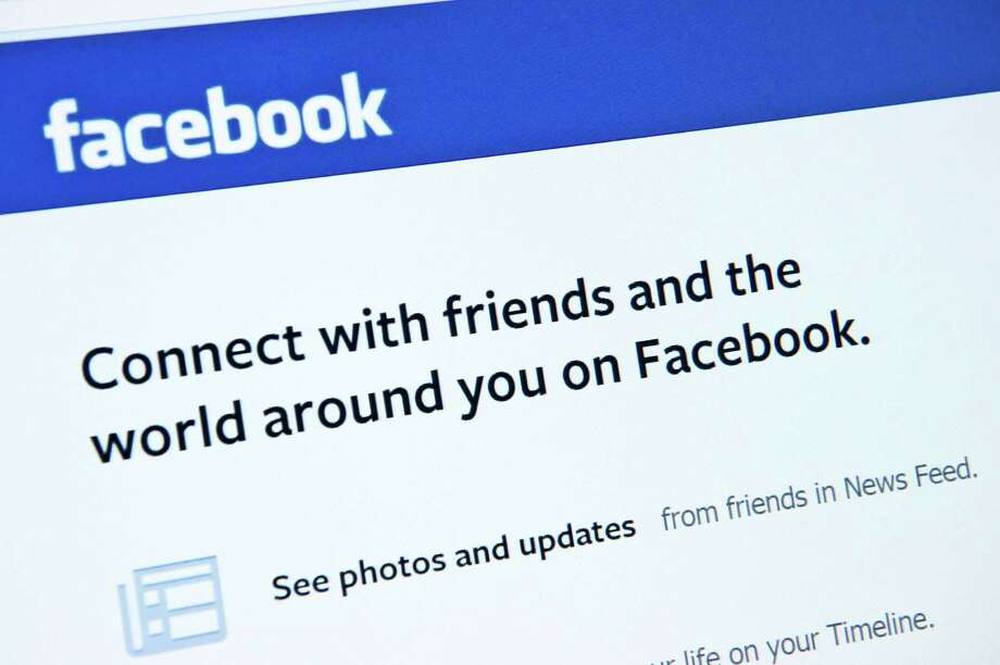 This January 30, 2014 photo taken in Washington,DC, shows the splash page for the social media internet site Facebook.  US stocks moved higher Thursday in early trade following solid US economic growth data, while Facebook's 14 percent gain on strong profits drove a 1.1 percent surge in the Nasdaq. AFP PHOTO / Karen BLEIERKAREN BLEIER/AFP/Getty Images Photo: KAREN BLEIER / AFP