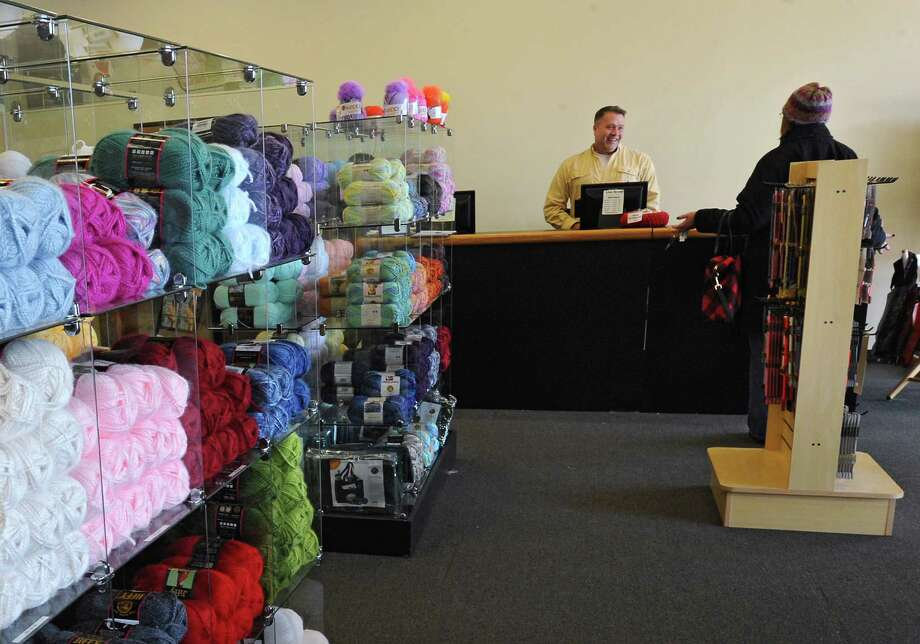 Manager James Conrad, left, talks to a customer at Lion Brand Yarn Shop located in the Kohl's plaza on Thursday, Jan. 30, 2014 in Colonie, N.Y.  (Lori Van Buren / Times Union) Photo: Lori Van Buren / 10025572A
