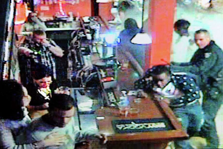 Screen grab from surveillance video taken at Kokopellis in Troy, N.Y., which shows Saturday's brawl with patrons and Troy Police. Photo: Cindy Schultz / 10025574A