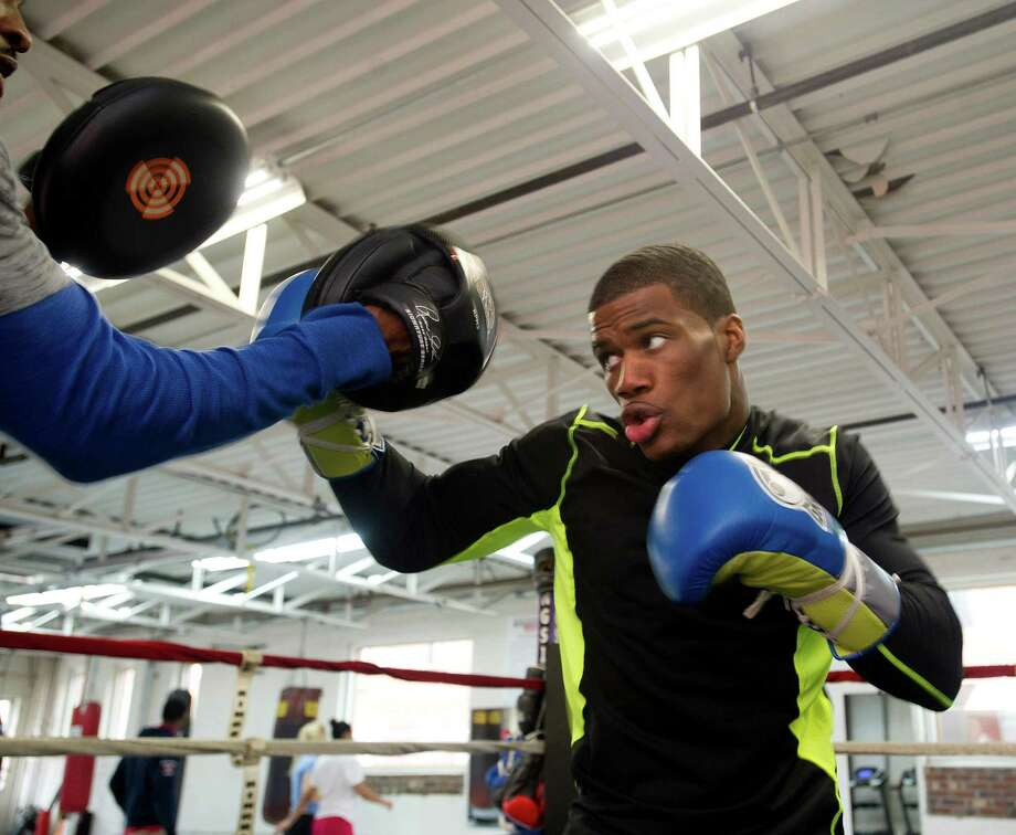 Chordale Booker trains with Ahmad Mickens at Revolution Fitness and Training in Stamford, Conn., on Thursday, January 16, 2014. Photo: Lindsay Perry / Stamford Advocate