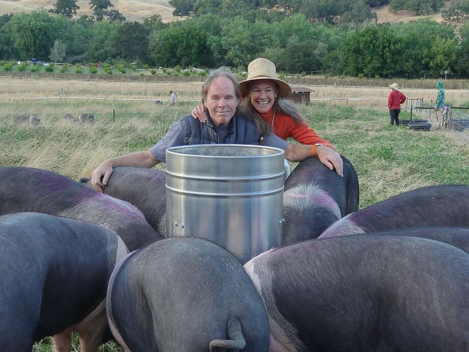 Peter and Mimi Buckley own Front Porch Farm and Acorn Ranch, where they raise Cinta Senese, Italian pigs that are prized for prosciutto. Photo: Courtesy Of Peter Buckley
