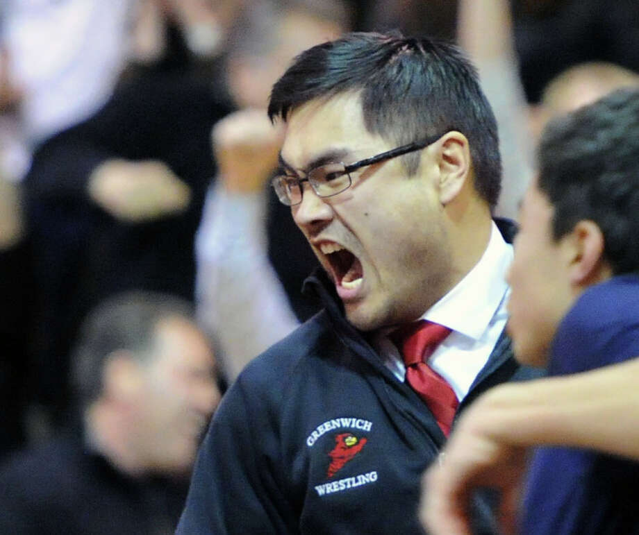 Kevin Chao, the asst. Greenwich High School wrestling coach, reacts during the high school wrestling match between Greenwich High School and Brunswick School at Brunswick in Greenwich, Tuesday, Jan. 28, 2014. Greenwich won the match, 42-27. Photo: Bob Luckey / Greenwich Time
