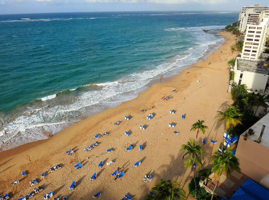 A wide, inviting beach in the Condado district, seen from the San Juan Marriott Resort. San Juan,