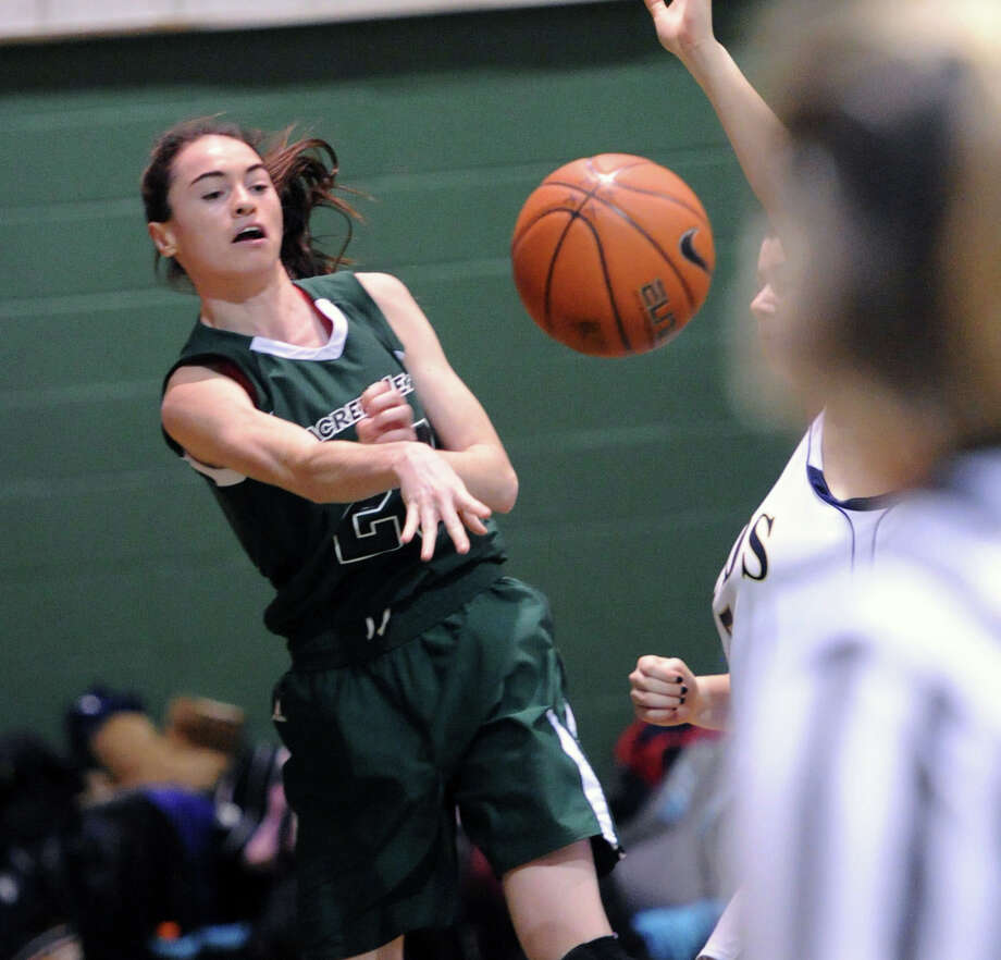 Colleen O'Neill (#23) of Convent of the Sacred Heart passes during the high school basketball game between Convent of the Sacred Heart and Rye Country Day School at Convent in Greenwich, Thursday, Jan. 30, 2014. Photo: Bob Luckey / Greenwich Time
