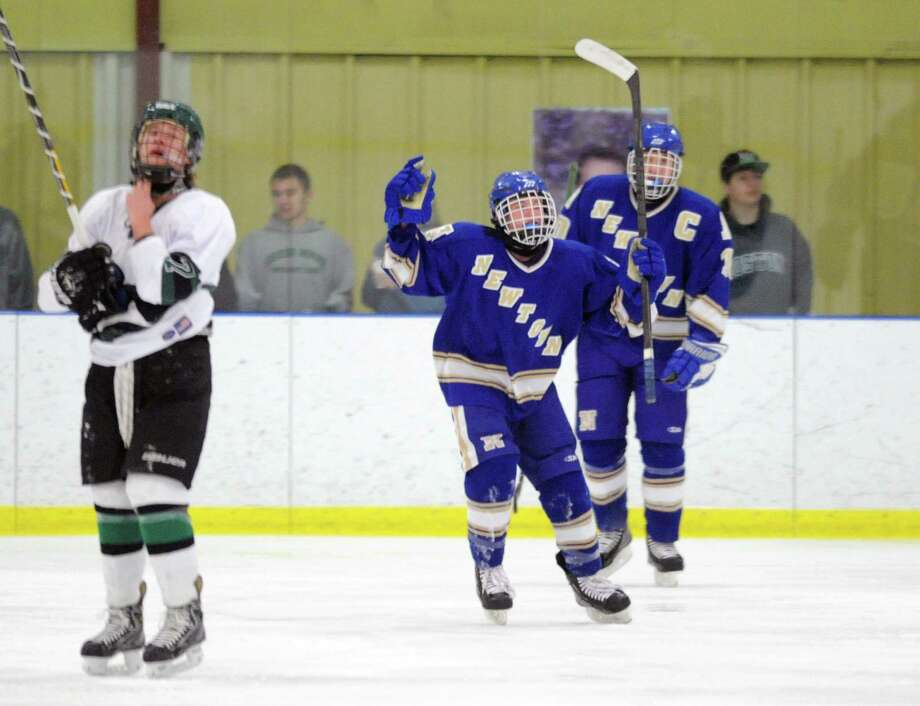 Photos from the high school boys hockey game between New Milford and Newtown at the Canterbury School's Drady Rink in New Milford, Conn. on Monday, Jan. 27, 2014. Photo: Tyler Sizemore / The News-Times