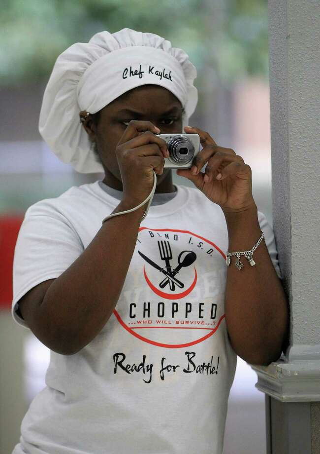 """Culinary Arts student Kaylah Moore, 17, takes photos at Dulles High School Cafeteria during the second annual cooking competition based loosely on the Food Network's hit show, """"Chopped"""", Thursday, Jan. 30, 2014. Photo: Karen Warren, Houston Chronicle / © 2013 Houston Chronicle"""