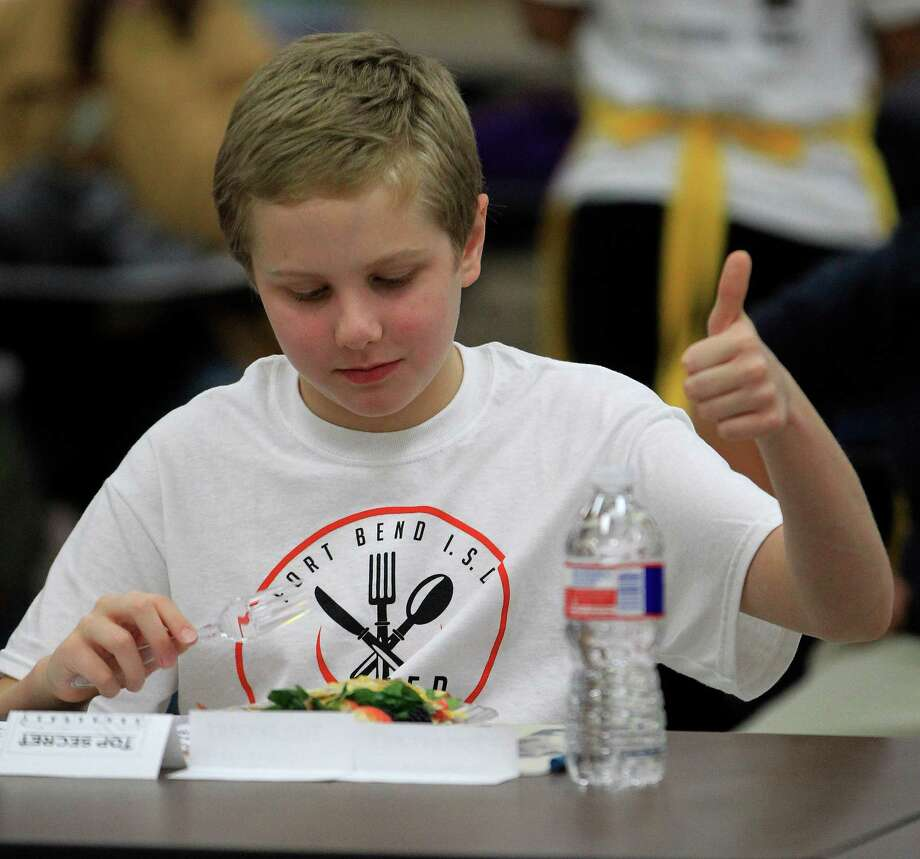 "Judge Joshua Cradic, 9, from Oyster Creek Elementary School, gives a thumbs up during judging at Dulles High School Cafeteria, during the second annual cooking competition based loosely on the Food Network's hit show, ""Chopped"", Thursday, Jan. 30, 2014. Photo: Karen Warren, Houston Chronicle / © 2013 Houston Chronicle"