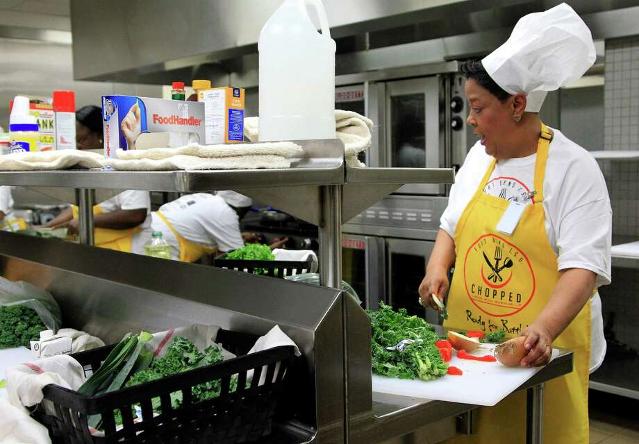 "Grace Dede, of Bush High School, chops vegetables in the kitchen at Dulles High School Cafeteria, during the second annual cooking competition based loosely on the Food Network's hit show, ""Chopped"", Thursday, Jan. 30, 2014. Photo: Karen Warren, Houston Chronicle / © 2013 Houston Chronicle"
