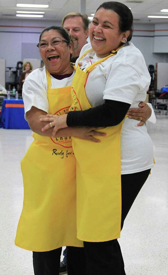 "Haydee Quinones, left, and her cooking partner Annie Hernandez hug after being awarded first place at Dulles High School Cafeteria, during the second annual cooking competition based loosely on the Food Network's hit show, ""Chopped"", Thursday, Jan. 30, 2014. Photo: Karen Warren, Houston Chronicle / © 2013 Houston Chronicle"