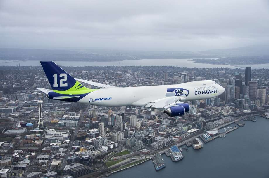 A Seattle Seahawks '12th Man' Boeing 747 flies over the Space Needle and Downtown Seattle on Jan. 30, 2014. (Monica M. Wehri/The Boeing Co.) Photo: Monica M. Wehri