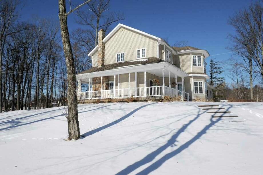 A home for sale on a private island in Mariaville Lake Thursday, Jan. 30, 2014, in Duanesburg, N.Y. (Michael P. Farrell/Times Union) Photo: Michael P. Farrell / 10025571A