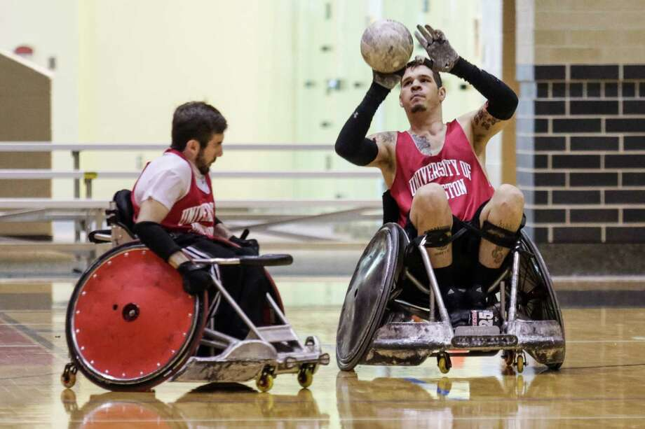 Eric Ingram, left, and Mason Symons get in some wheelchair rugby practice time at the University of Houston, which this weekend is hosting a tournament. Photo: Courtesy Of University Of Housto, Staff Photographer / Thomas Campbell