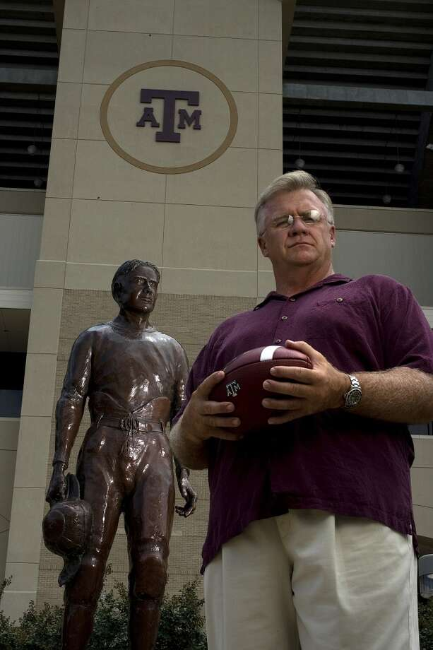 Portrait of Texas A&M head football coach Mike Sherman next to the 12th Man statue outside Kyle Field Wednesday, Aug. 20, 2008, in College Station. ( Johnny Hanson / Chronicle ) Photo: Johnny Hanson, Houston Chronicle