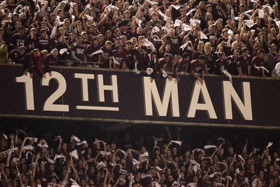 The Texas A&M 12th Man screams and hollers during the fourth quarter of the Texas A&M-Nebraska college football game, Nov. 20, 2010, at Kyle Stadium in College Station. Texas A&M won the game 9-6.  ( Karen Warren / Houston Chronicle ) Photo: Karen Warren, Chronicle