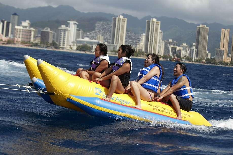 Now managed by Roberts Hawaii, Waikiki Ocean Club rents watercraft, including banana sleds, from a platform off Waikiki Beach. Photo: Roberts Hawaii