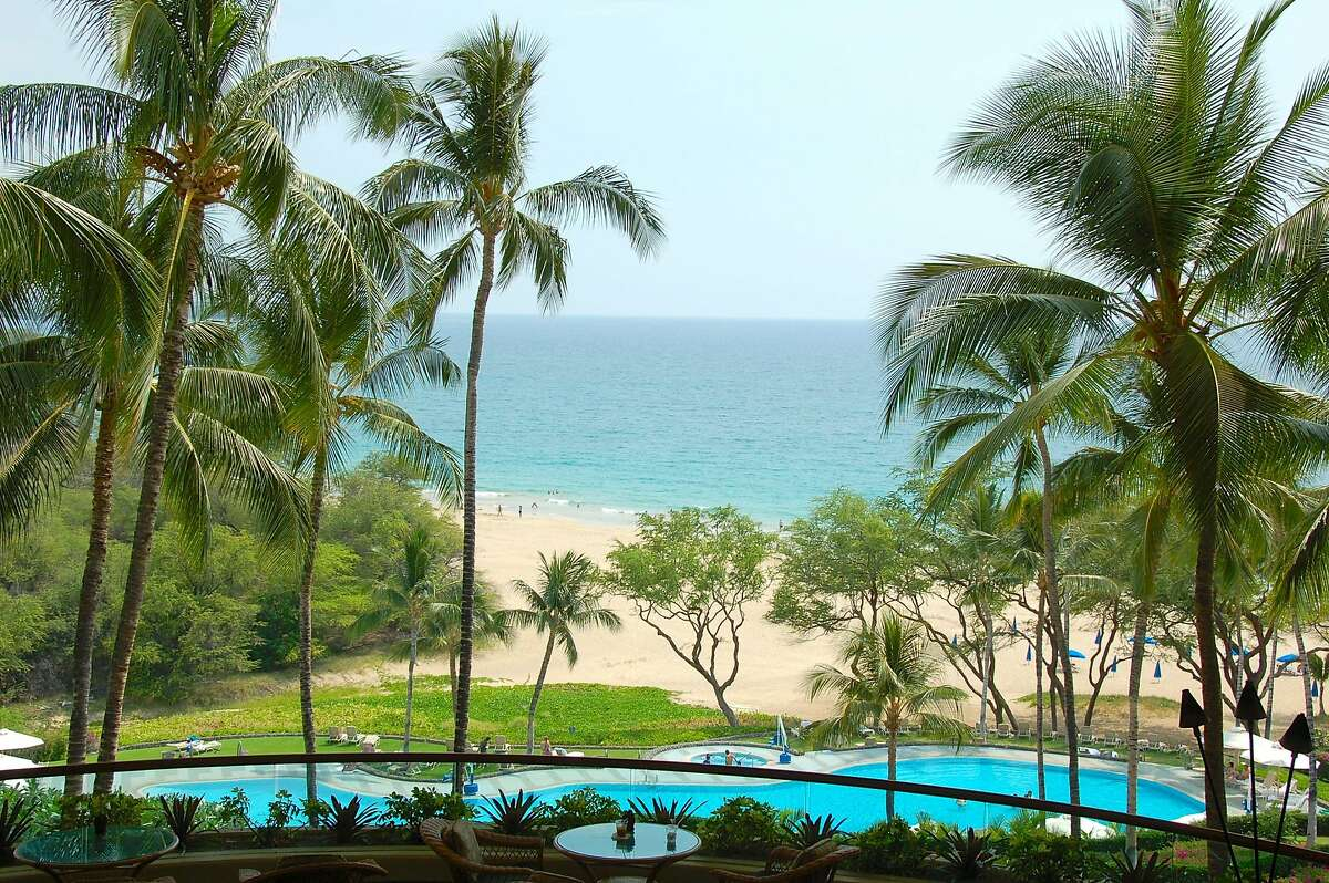 The lobby at the Hapuna Beach Prince Hotel provides a view of the eponymous beach and the newly refurbished pool.