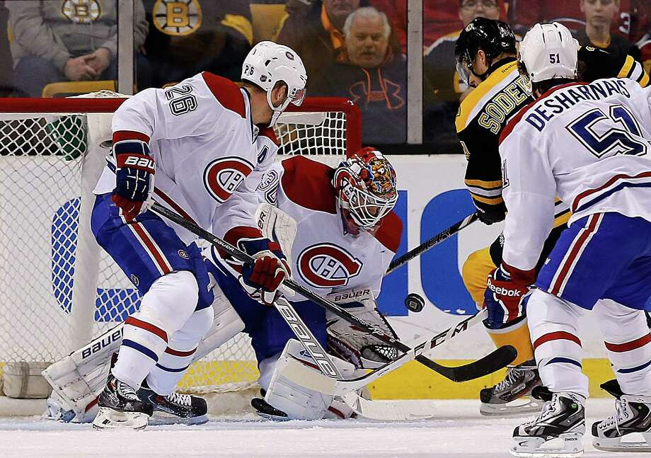 BOSTON, MA - JANUARY 30:  Peter Budaj #30 and Josh Gorges #26 of the Montreal Canadiens defends the goal  against Carl Soderberg #34 of the Boston Bruins in the second period at TD Garden on January 30, 2014 in Boston, Massachusetts.  (Photo by Jim Rogash/Getty Images) ORG XMIT: 181113727 Photo: Jim Rogash / 2014 Getty Images