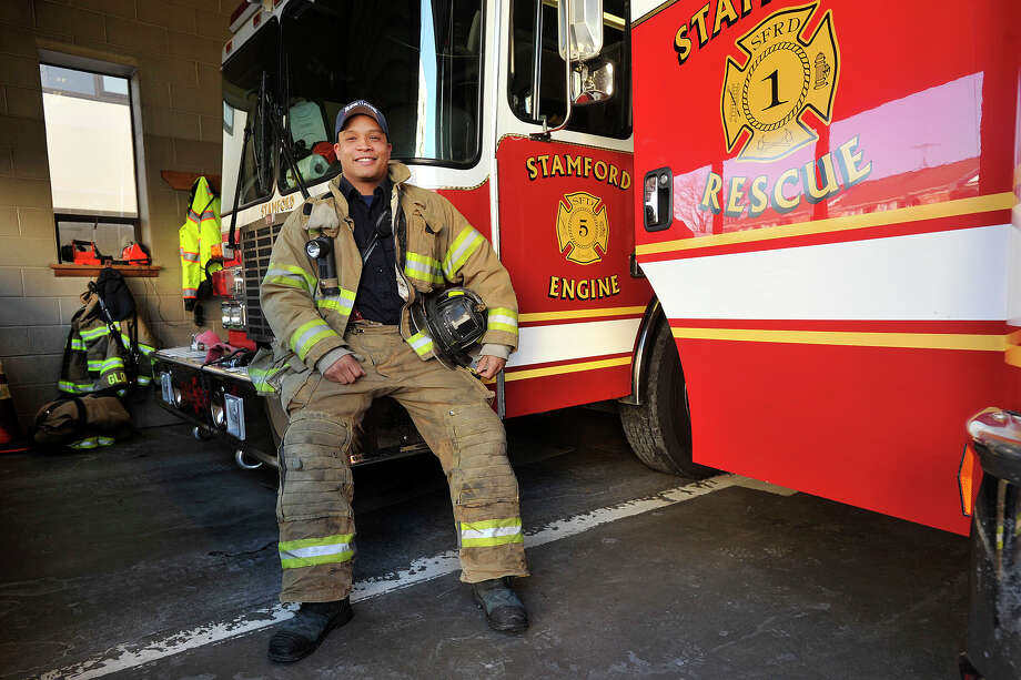 Stamford firefighter Zachary McArthur sits in Station 5 in Stamford on Thursday. McArthur saved a dog from a burning building in Cheshire on Tuesday while on a trip to see family. Photo: Jason Rearick / Stamford Advocate