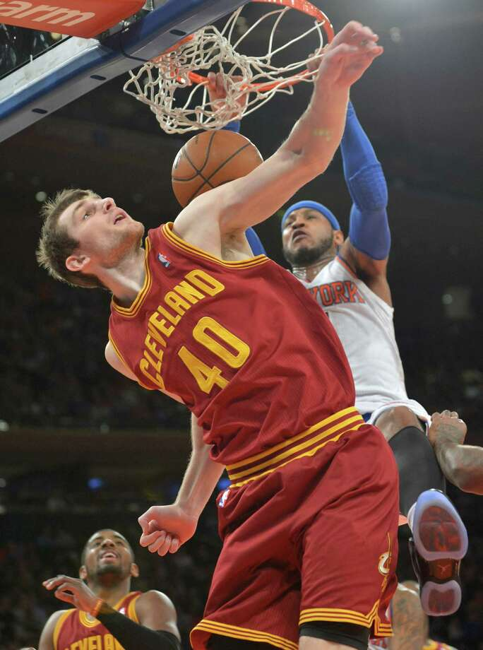 New York Knicks' Carmelo Anthony dunks the ball over Cleveland Cavaliers' Tyler Zeller (40) during the first quarter of an NBA basketball game Thursday, Jan. 30, 2014, at Madison Square Garden in New York. (AP Photo/Bill Kostroun) ORG XMIT: NYBK102 Photo: Bill Kostroun / FR51951 AP