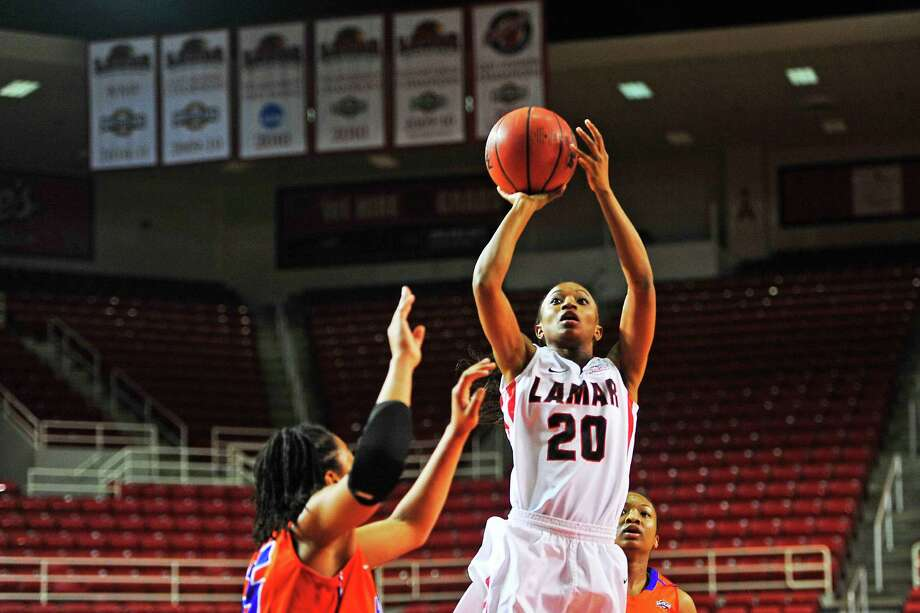 Lamar Lady Cardinals JaMeisha Edwards, No. 20, shoots a three point shot during Thursday's game against Houston Baptist Lady Huskies at the Montagne Center. Michael Rivera/@michaelrivera88