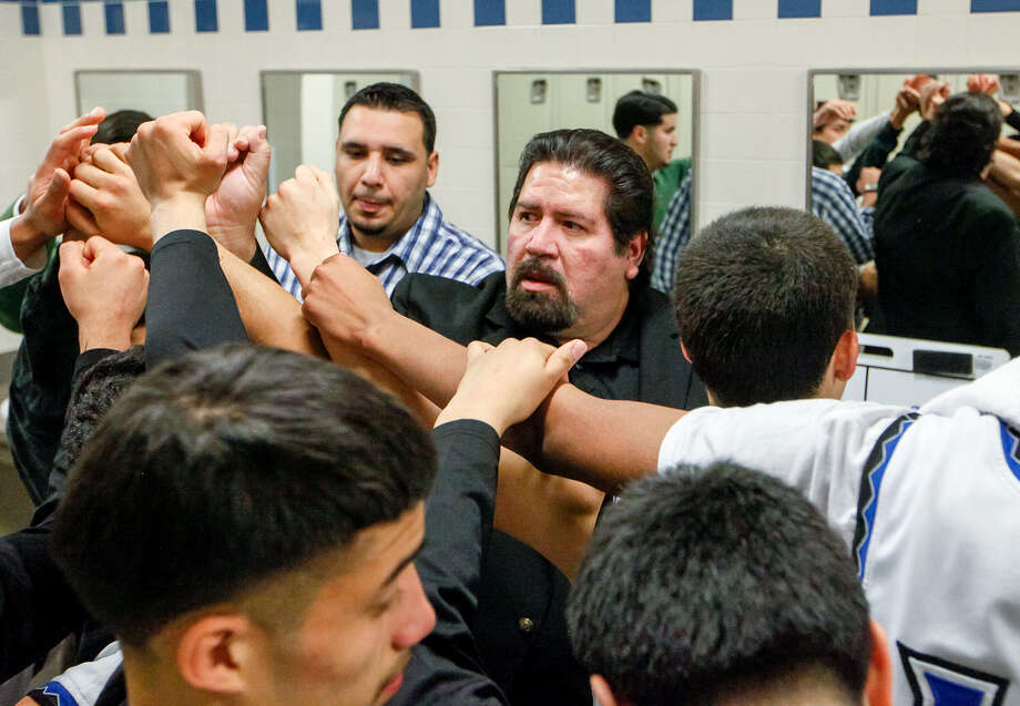 "Rudy Bernal (center) has led Lanier to the playoffs in 11 of the past 14 seasons, including trips to the state tournament in 2000 and 2001. ""At Lanier, you're expected to win,"" said Voks assistant Jesus De Hoyos, a former player under Bernal. Photo: Marvin Pfeiffer / San Antonio Express-News / Express-News 2013"