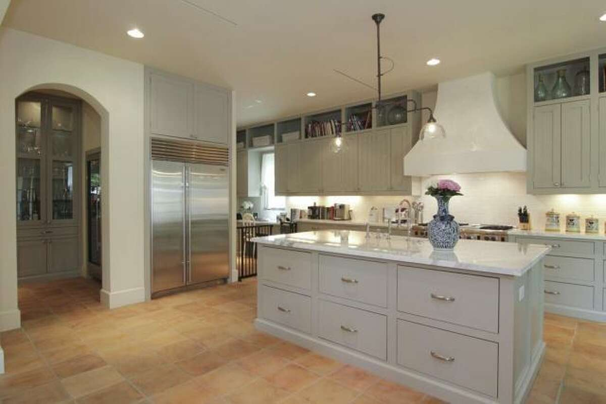 The kitchen includes an island with a deep sink, a 48-inch SubZero fridge and a butler's pantry.