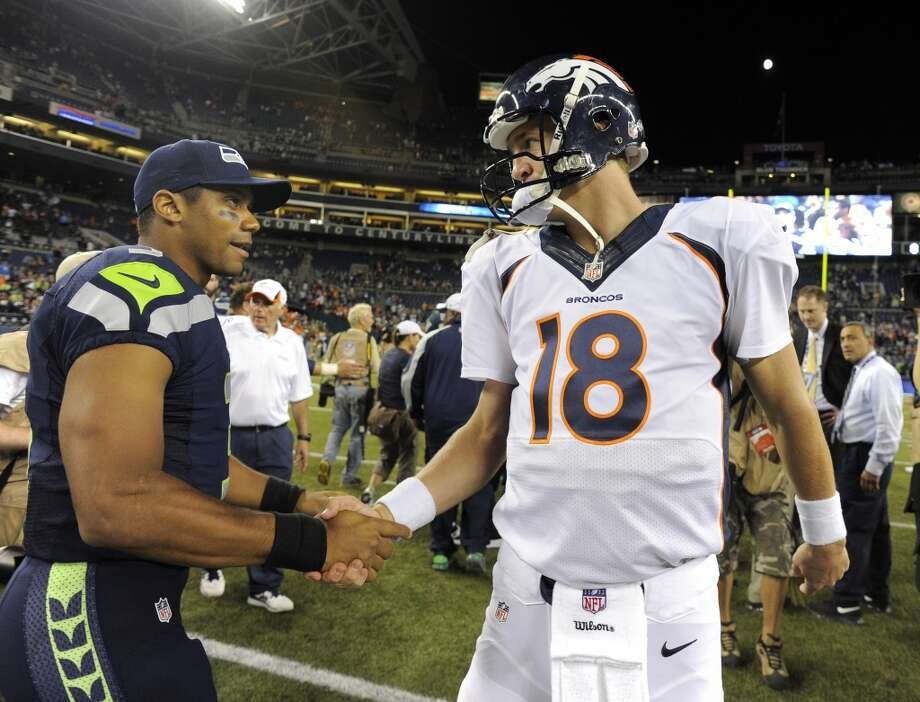Student and the masterWhen Manning won his Super Bowl ring in February of 2007, Wilson was a high school senior. But by that point, the two had actually met. When Wilson was a sophomore, he attended the Manning Passing Academy and was one of about a dozen kids in Peyton Manning's group. At the camp, Wilson has said, he learned about the immense preparation and studying it takes to be a successful quarterback in the National Football League. Photo: John Leyba, Denver Post Via Getty Images